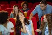 Annoying woman on the phone during movie — Stock Photo