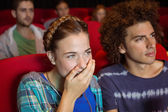Young couple watching a film — Stockfoto