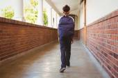 Girl walking in school corridor — Fotografia Stock