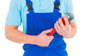 Repairman holding adjustable wrench — Stock Photo