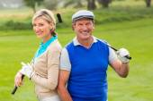 Couple smiling on putting green — Stock Photo