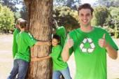 Environmental activists hugging a tree — Stock Photo