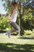 Fit woman skipping in the park — Stock Photo