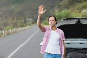 Man waving after a breakdown — Stock Photo