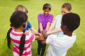 Children holding hands together at park — Stock Photo