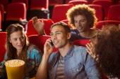 Annoying man on the phone during movie — Zdjęcie stockowe