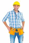 Handyman standing with hands on hips — Stock Photo