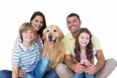 Happy family with golden retriever — Stock Photo