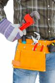 Handyman holding hand tool — Stock Photo