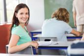 Beautiful female student in class — Stock Photo
