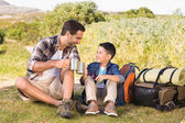 Father and son on a hike together — Stok fotoğraf