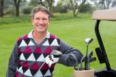 Happy golfer beside his golf buggy — Stock Photo