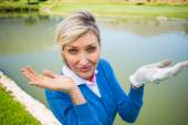 Worried female golfer looking for golf ball  — Stock Photo