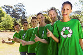 Environmental activists smiling at camera — Stock Photo