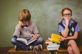 Kids with stack of books in classroom — Foto de Stock