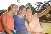 Students taking selfie outside on campus — Stock Photo