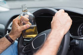 Man drinking alcohol while driving — Stock Photo