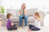 Upset mother looking at children — Stock Photo