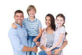 Happy parents carrying children over white background — Stock Photo