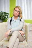 Pretty student frowning at camera — Stock Photo