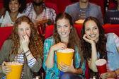 Young friends watching a film — Fotografia Stock