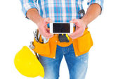 Repairman showing mobile phone — Stock Photo