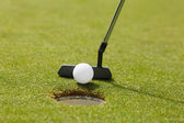 Golf club putting ball at the hole — Stock Photo