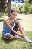 Fit woman with injured ankle — Stock Photo