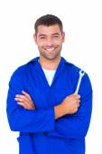 Smiling male mechanic holding spanner — Stock Photo