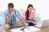 Stressed couple calculating home finances — Stock Photo