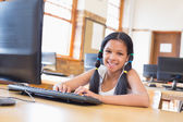 Cute pupil in computer class — Stock Photo