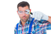 Confident repairman looking through wrench — Stock Photo