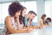Fashion students taking notes in class — Stock Photo