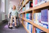 Smiling disabled student in library — 图库照片