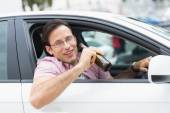 Man drinking beer while driving — Stock Photo