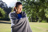 Pretty woman wrapped in blanket — Stock Photo