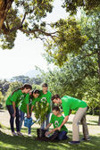 Environmental activists planting a tree — Stock Photo