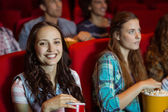 Young friends watching a film — Photo