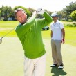 Golfing friends teeing off — Stock Photo #68990155