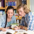 College students doing homework in library — Stock Photo #68991009