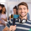 Happy male student in college — Stock Photo #68993251