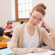 Thinking teacher sitting at desk  — Stock Photo #68994605