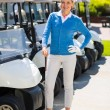 Female golfer beside golf buggy  — Stock Photo #68994759