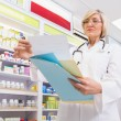 Concentrated doctor reading a prescription — Stock Photo #68998597
