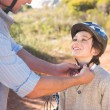 Father clipping on sons helmet — Stock Photo #68998767