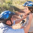 Father clipping on sons helmet — Stock Photo #68999175