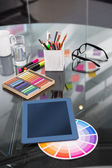 Colour samples and digitizer on desk — Stock Photo