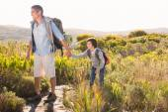 Father and son hiking through mountains — Stock Photo