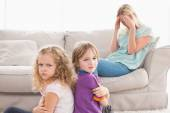 Angry siblings sitting arms crossed — Stock Photo