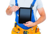Midsection of repairman holding digital tablet — Stock Photo